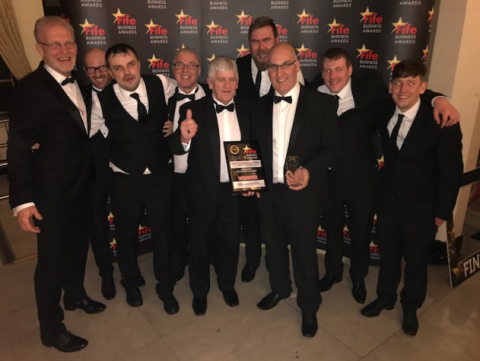 Winning EPS team, with Steve Goodlad COO (holding prize) with Nick Palmer Managing Director (1st left) and the EPS production team based at Fife, Kirkcaldy